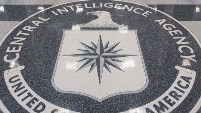 """TO GO WITH AFP STORY by Dan De Luce, Iraq-war-10years-US-spy (FILES) The Central Intelligence Agency (CIA) logo is displayed in the lobby of CIA Headquarters in Langley, Virginia, in this August 14, 2008 file photo. US spy agencies still live under the shadow of disastrous intelligence failures that paved the way for the Iraq war, and now face a crucial test as they track Iran's nuclear program. In the run-up to the invasion of Iraq 10 years ago, the CIA and other intelligence services confidently asserted that Saddam Hussein's regime had stockpiles of weapons of mass destruction. Their findings backed up the White House's strongly-held conviction that Saddam was a menace who had to be toppled by force. But it turned out the intelligence community was """"dead wrong in almost all of its pre-war judgments about Iraq's weapons of mass destruction,"""" according to an official inquiry, the Silberman-Robb report.     AFP PHOTO/SAUL LOEB/FILES"""