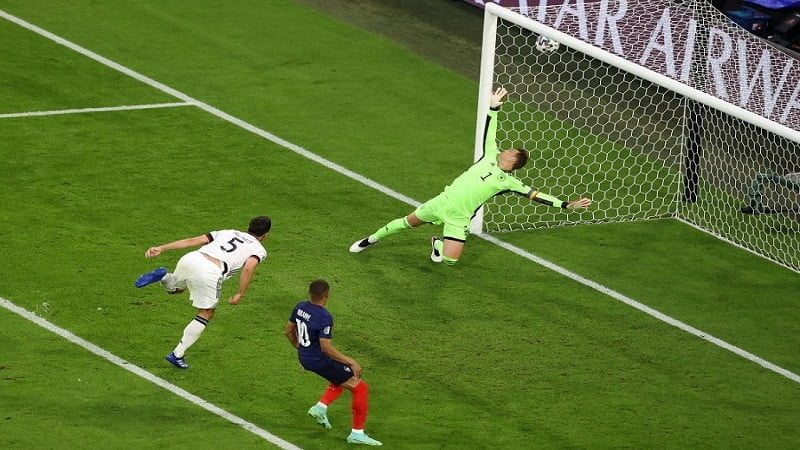 MUNICH, GERMANY - JUNE 15: Mats Hummels of Germany scores an own goal past team mate Manuel Neuer for France's first goal during the UEFA Euro 2020 Championship Group F match between France and Germany at Football Arena Munich on June 15, 2021 in Munich, Germany. (Photo by Alexander Hassenstein/Getty Images)
